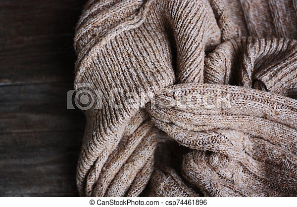 Beautiful brown knitted fabric close up view - csp74461896