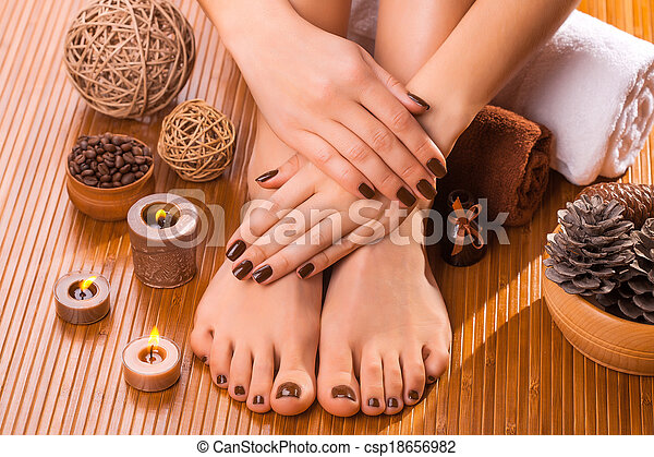 beautiful brown manicure and pedicure on the bamboo - csp18656982