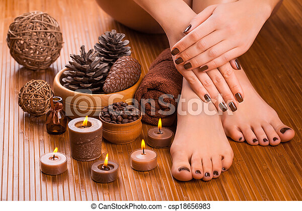 beautiful brown manicure and pedicure on the bamboo - csp18656983