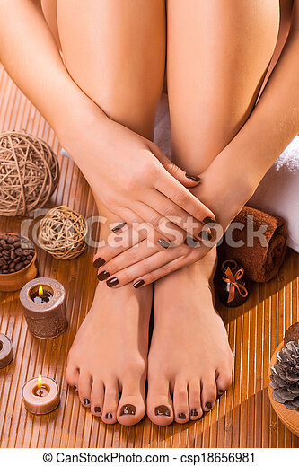 beautiful brown manicure and pedicure - csp18656981