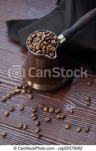 Beautiful brown Turk with coffee beans view - csp50379062