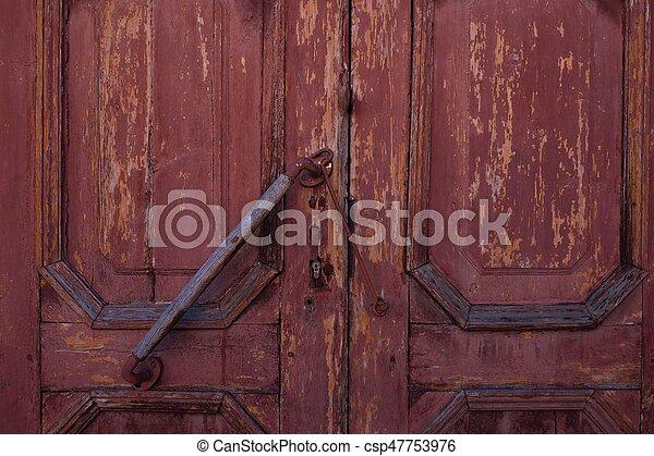 Beautiful brown wooden background door locks - csp47753976