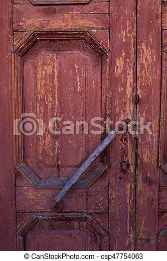 Beautiful brown wooden background door locks - csp47754063