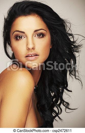 beautiful brunett model in studio on light background - csp2472611