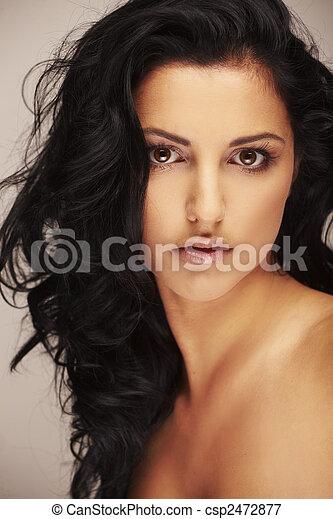 beautiful brunett model in studio on light background - csp2472877
