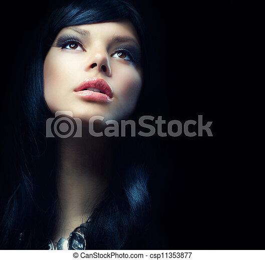 Beautiful Brunette Girl over Black Background. Darkness  - csp11353877