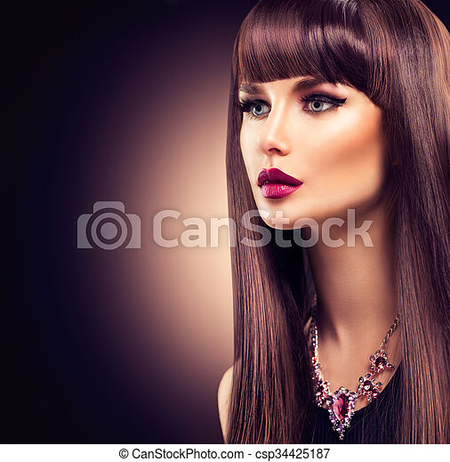Beautiful brunette girl with healthy long hair - csp34425187