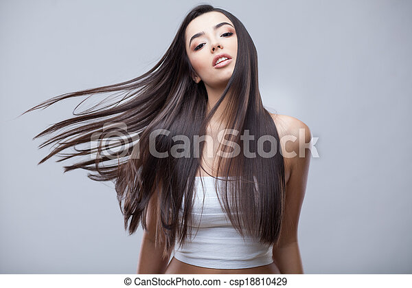 Beautiful Brunette Girl with Healthy Long Hair - csp18810429