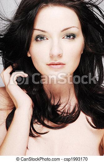 Beautiful brunette on grey/gray background - csp1993170