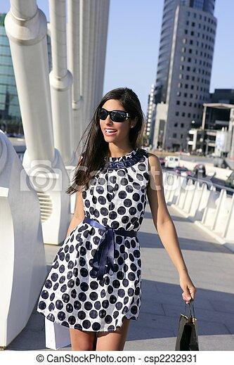 Beautiful brunette shopaholic outdoor city - csp2232931