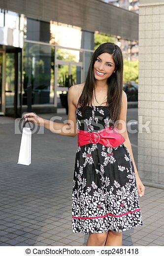 Beautiful brunette shopaholic outdoor city - csp2481418