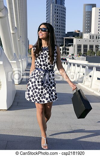 Beautiful brunette shopaholic outdoor city - csp2181920