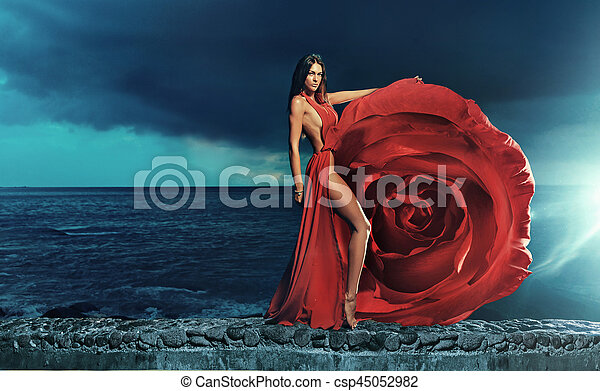 Beautiful brunette wearing rose dress - csp45052982