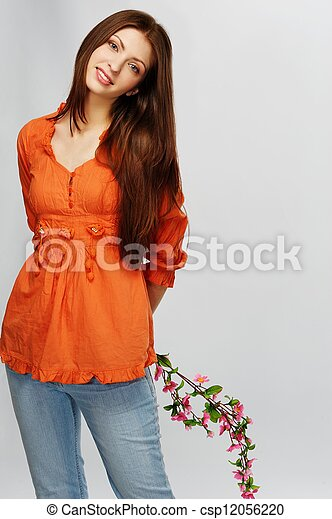 Beautiful brunette woman with a flowers - csp12056220