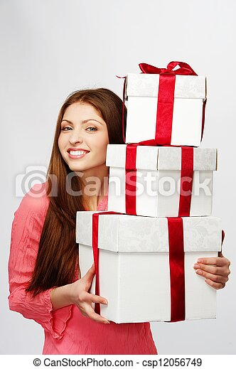 Beautiful brunette woman with a gift boxes - csp12056749