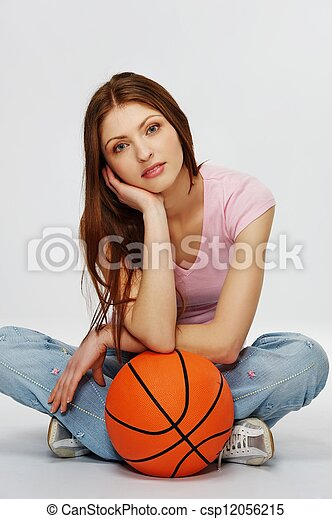 Beautiful brunette woman with a basketball - csp12056215