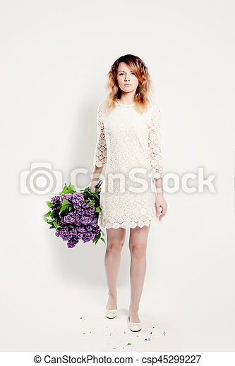 Beautiful Brunette Woman with flowers - csp45299227
