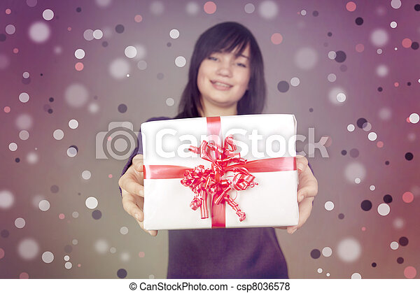Beautiful brunette woman with present box in the hands - csp8036578