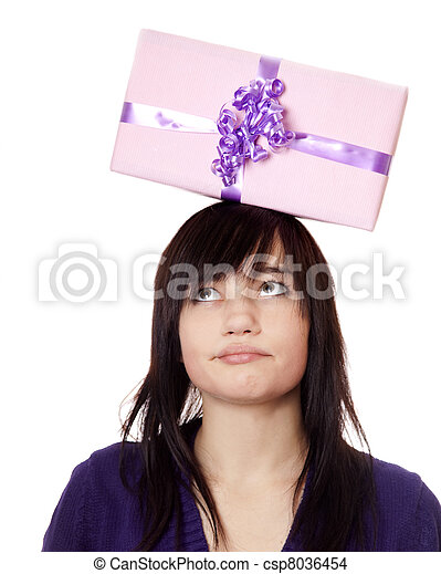 Beautiful brunette woman with present box over head. - csp8036454