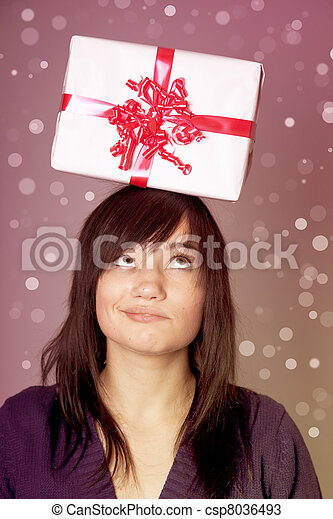 Beautiful brunette woman with present box over head. - csp8036493