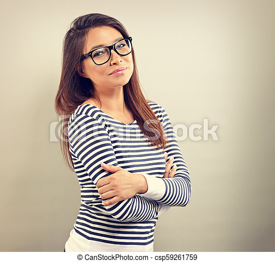 Beautiful business positive woman in glasses looking with thinking look on empty space background. Vintage portrait - csp59261759