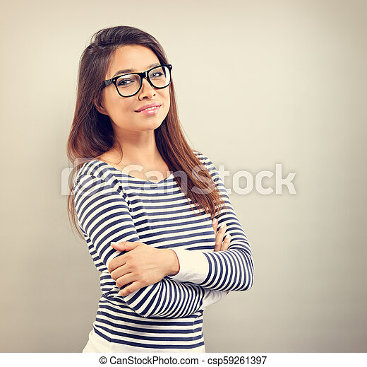 Beautiful business positive woman in glasses looking with thinking look on empty space background. Vintage portrait - csp59261397
