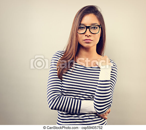 Beautiful business serious woman in glasses looking with thinking look on empty space background. Toned vintage portrait - csp59405752