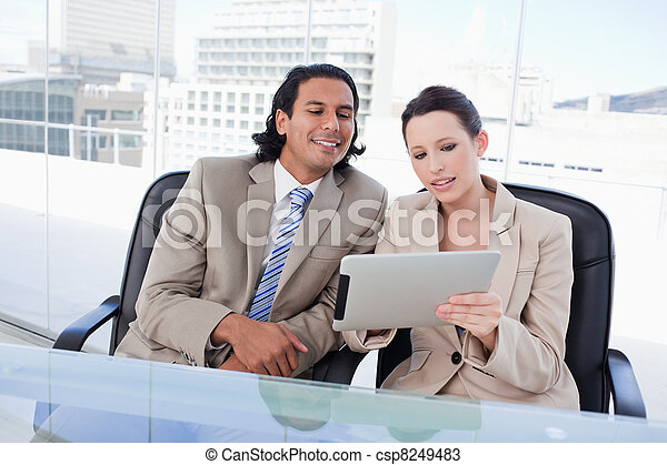 Beautiful business team using a tablet computer - csp8249483