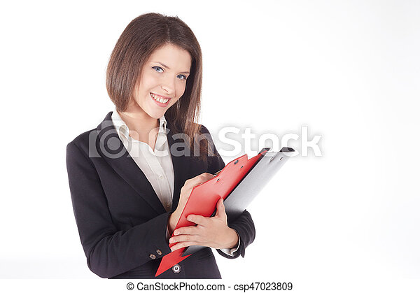 Beautiful business woman taking notes on her clipboard isolated on white background - csp47023809