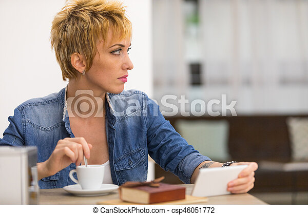 Beautiful business woman working in cafe - csp46051772