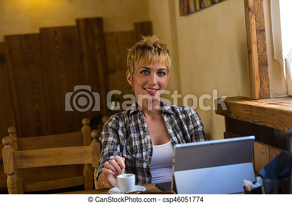 Beautiful business woman working in cafe - csp46051774
