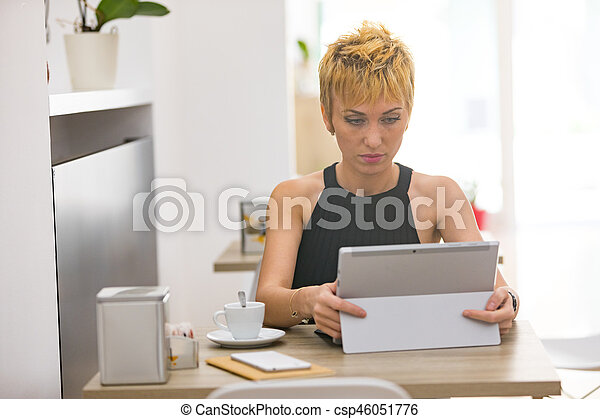 Beautiful business woman working in cafe - csp46051776