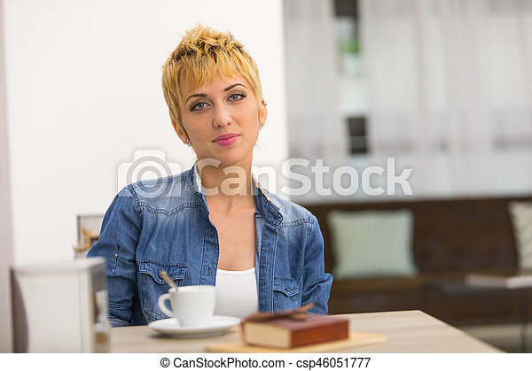 Beautiful business woman working in cafe - csp46051777