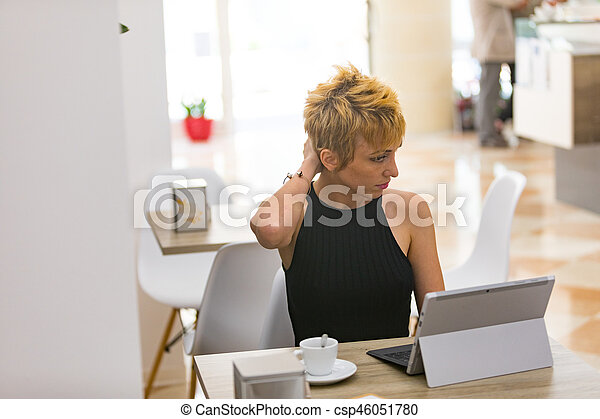 Beautiful business woman working in cafe - csp46051780