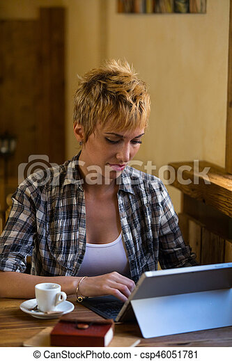 Beautiful business woman working in cafe - csp46051781