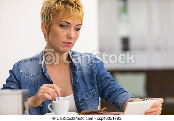 Beautiful business woman working in cafe - csp46051793