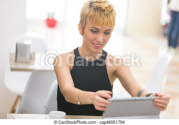 Beautiful business woman working in cafe - csp46051794