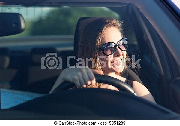 Beautiful businesswoman driving the car - csp15051283