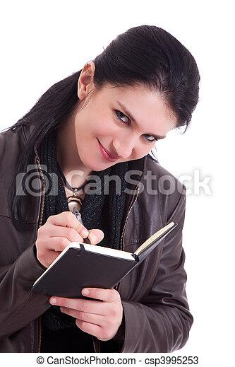 beautiful businesswoman taking notes, isolated on white background. Studio shot. - csp3995253