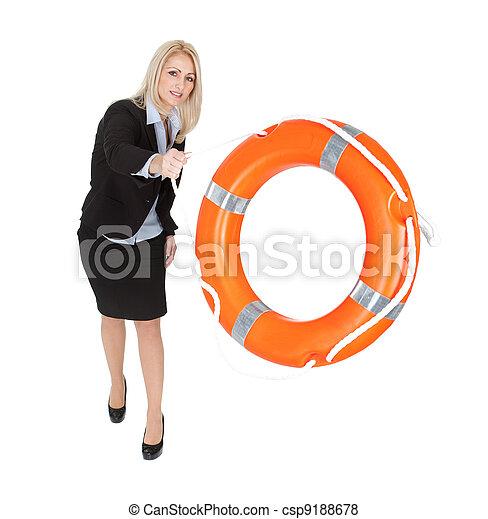 Beautiful businesswoman throwing life buoy - csp9188678