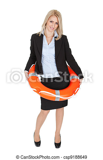 Beautiful businesswoman with life buoy - csp9188649
