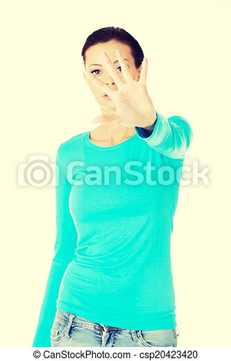 beautiful casual woman with her hand in front. - csp20423420