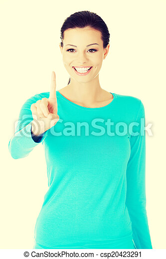 beautiful casual woman with pointing finger. - csp20423291