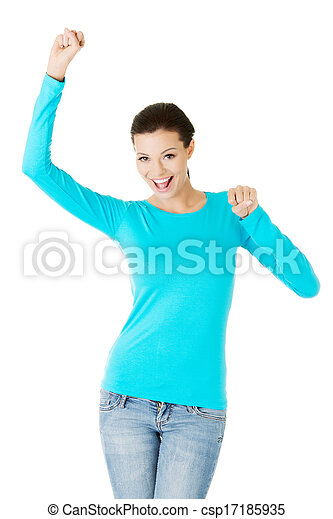 beautiful casual woman with raised fists. - csp17185935