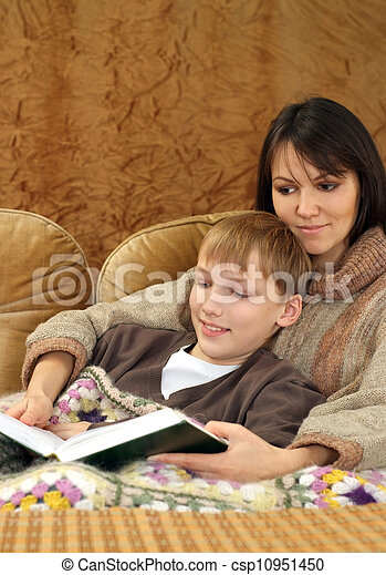 Beautiful charming Caucasian mother with her son reading a book - csp10951450