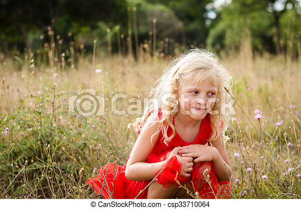 beautiful child in meadow - csp33710064