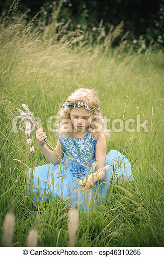 beautiful child in the meadow - csp46310265