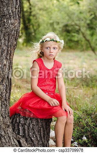 beautiful child waiting in forrest - csp33709978