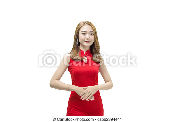 Beautiful chinese woman in traditional dress standing - csp62394441