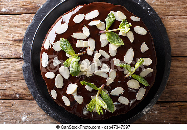Beautiful Chocolate Cake Decorated With Almonds And Mint Close Up On